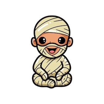 Schattige kleine jongen mummie cartoon zitten