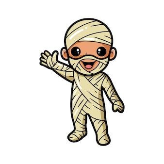 Schattige kleine jongen mummie cartoon zwaaiende hand