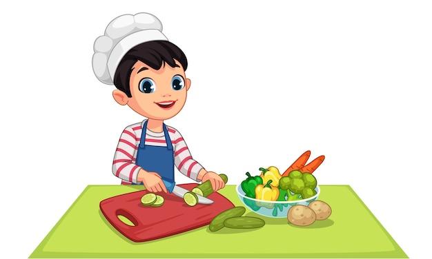 Schattige kleine jongen snijden groenten illustratie