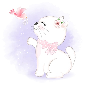 Schattige kleine kat met vogel hand
