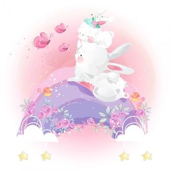 Schattige kleine konijn en regenboog in heldere hemel.