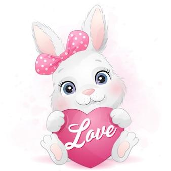 Schattige kleine konijntje knuffelen een hart