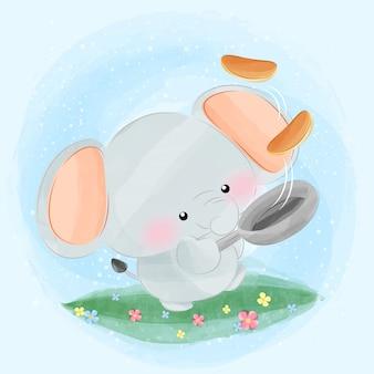 Schattige kleine olifant koken pannenkoeken