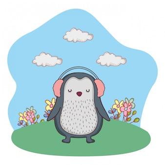 Schattige kleine pinguïn met oortelefoons in het park