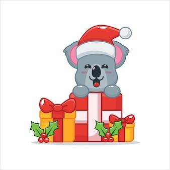 Schattige koala blij met kerstcadeau leuke kerst cartoon illustratie