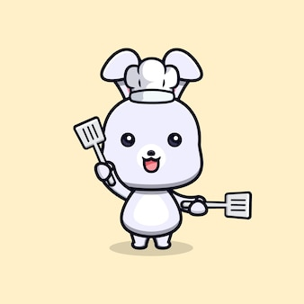 Schattige konijnenchef-kok met spatel dier mascotte karakter