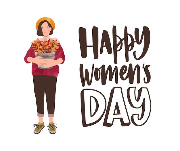 Schattige lachende meisje met emmer vol prachtige lentebloemen en gelukkige vrouwendag wens geschreven met elegante lettertype.