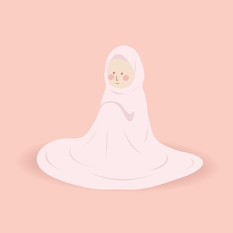 Schattige moslima zuster in roze gebedskleding mukena doet een gebed in een daad van het aanbidden van allah