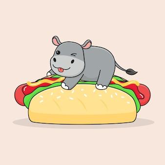 Schattige nijlpaard bovenop hotdogs