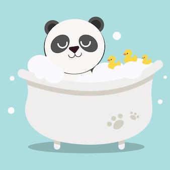 Schattige panda met drie rubberen eenden in een badkuip op lichtblauwe achtergrond
