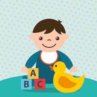 Schattige peuter jongen blokken alfabet en eend speelgoed