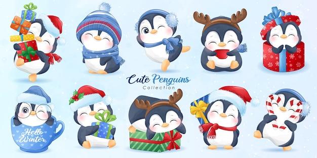 Schattige pinguïns ingesteld voor kerstdag met aquarel illustratie