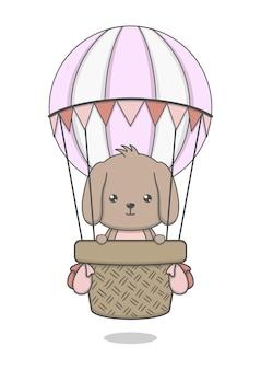 Schattige puppy hondje rijden hete luchtballon