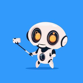 Schattige robot nemen selfie foto geïsoleerd pictogram op blauwe achtergrond moderne technologie kunstmatige intelligentie