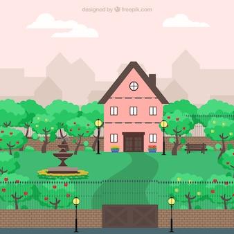 Schattige roze huis in een grote tuin