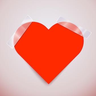 Schattige roze sticker in de vorm van een hart bevestigd met plakband.