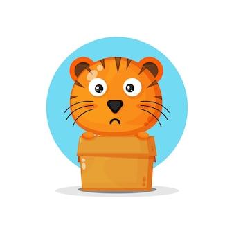 Schattige tijger in de doos geïsoleerd op blauw