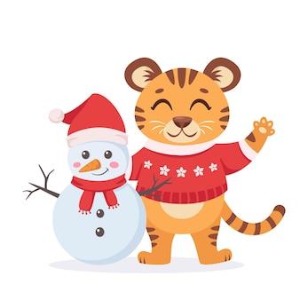 Schattige tijger in een trui met sneeuwpop jaar van de tijger