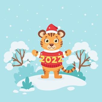 Schattige tijger in een trui wenst een gelukkig nieuwjaar 2022, jaar van de tijger