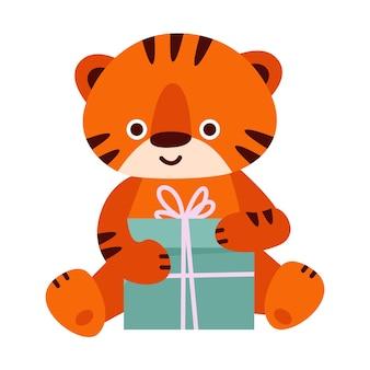 Schattige tijger met een geschenkdoos. vectorillustratie in cartoon-stijl. geïsoleerd op een witte achtergrond.