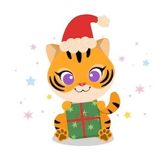 Schattige tijger met kerstmuts en kerstcadeau