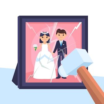 Scheidingsconcept met het breken van frame met hamer