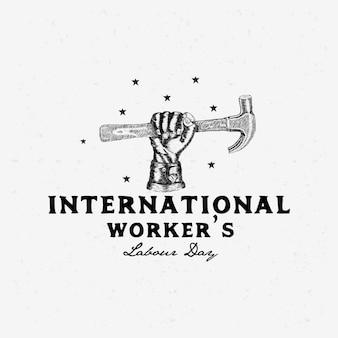 Schets van hand werelddag van de arbeid met grunge