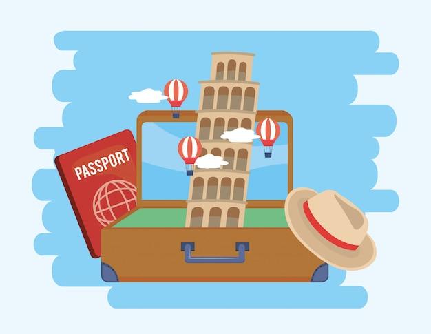 Scheve toren van pisa in de koffer met paspoort en hoed