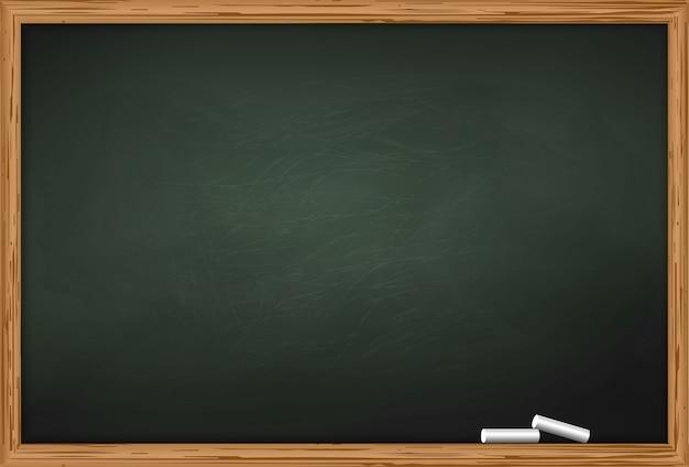 Schoolbord met twee stukjes krijt