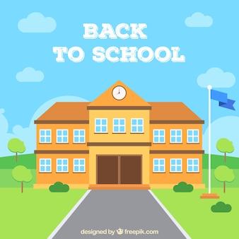 Schoolgebouw en golvende vlag met vlak ontwerp