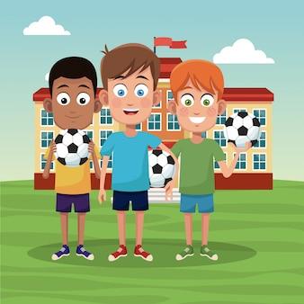 Schooljongens met voetballen