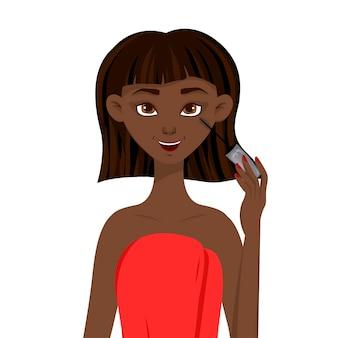 Schoonheid afrikaanse vrouw past mascara toe.