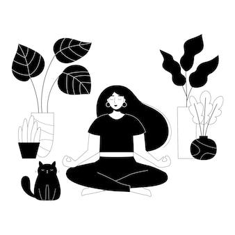 Schoonheid vrouw in yoga lotus pose met schattige dikke kat en kamerplanten in potten
