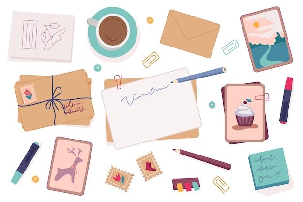 Schrijvers set ansichtkaarten en enveloppen decoratieve potloden en pennen
