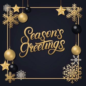 Seasons greetings handgeschreven letters met gouden decoratie ornament.