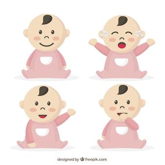 Selectie van de baby met roze pyjama's in verschillende houdingen