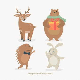Selectie van vier lachende dieren in het bos