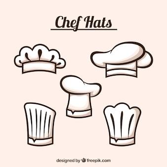 Selectie van vijf platte chef-kok hoeden
