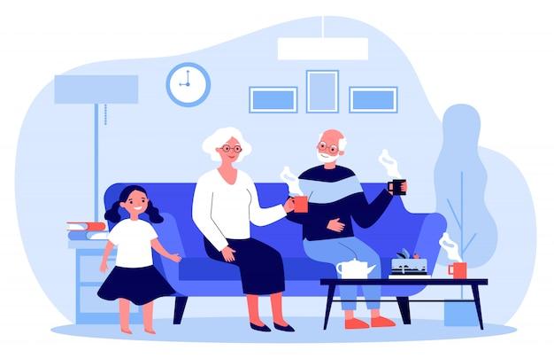 Senior paar met kleindochter genieten van thee