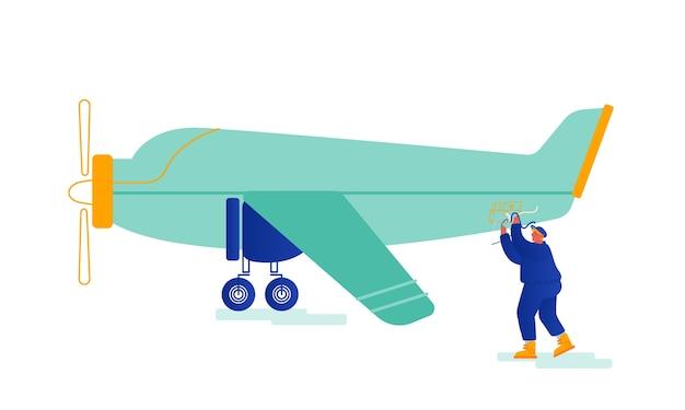 Service-ingenieur reparatie vintage vliegtuig met propellermotor op luchtvaartterrein reparatie gebroken draden.