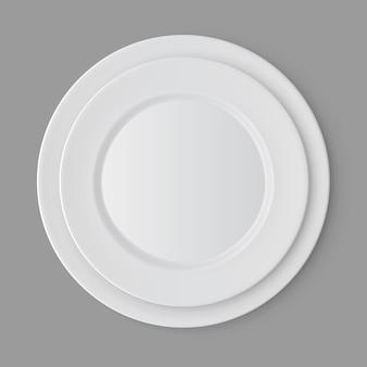 Servies set witte lege platen geïsoleerd, bovenaanzicht