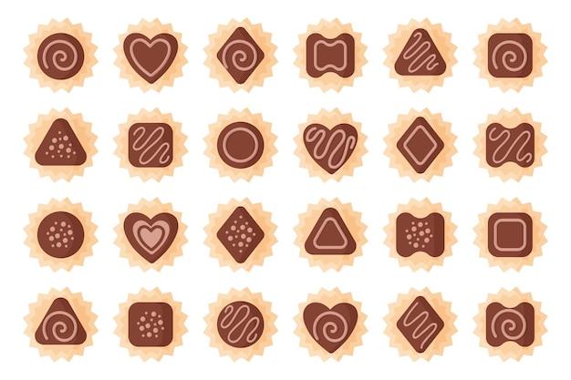 Set chocolaatjes van verschillende vormen met suikerglazuur.