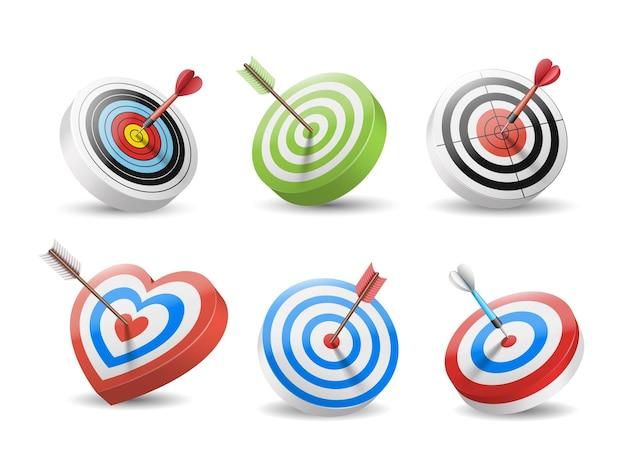 Set doelen en pijlen in bullseye geïsoleerd. dart- en boogschietpijlen in het midden van doelen. Premium Vector