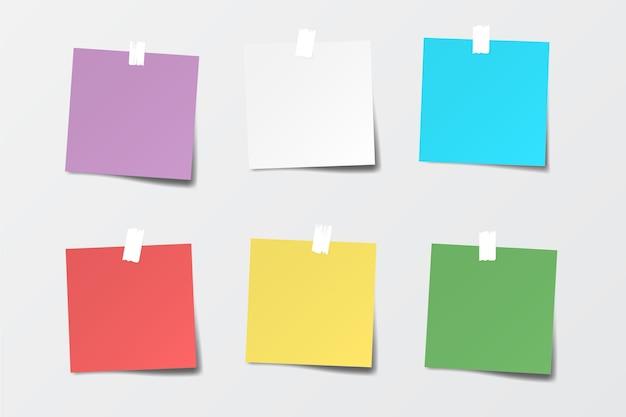 Set gekleurde papieren notities.