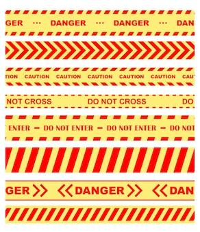 Set gekleurde waarschuwings-, gevaar- en chevronlinten of tape die de toegang in oranje en geel beperkt