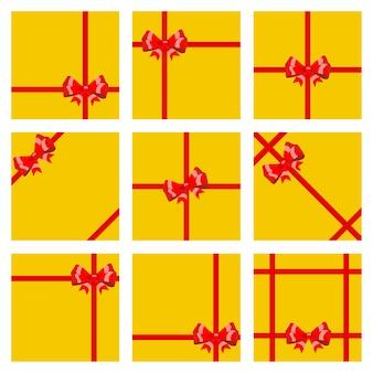 Set gele geschenkdozen, vastgebonden met rode linten en strikken. bovenaanzicht. vlak