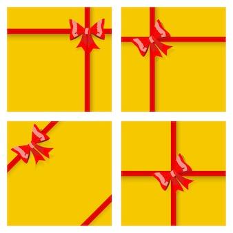 Set gele geschenkdozen, vastgebonden met rode linten en strikken, met schaduwen. bovenaanzicht. plat ontwerp
