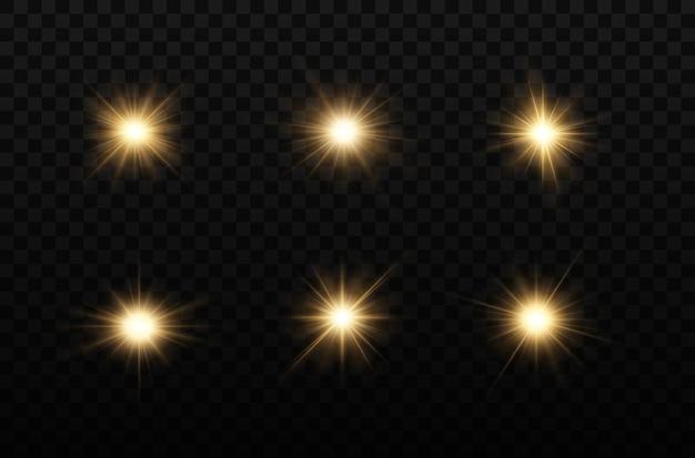 Set glanzende gouden sterren lichteffect bright star kerstster gouden gloeiend licht ontploft