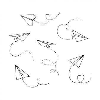 Set hand getrokken doodle papieren vliegtuigje geïsoleerd op een witte achtergrond. lijn pictogram symbool van reizen en route.