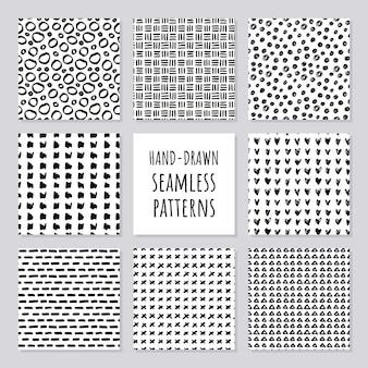 Set handgetekende naadloze zwart-witte patronen illustratie
